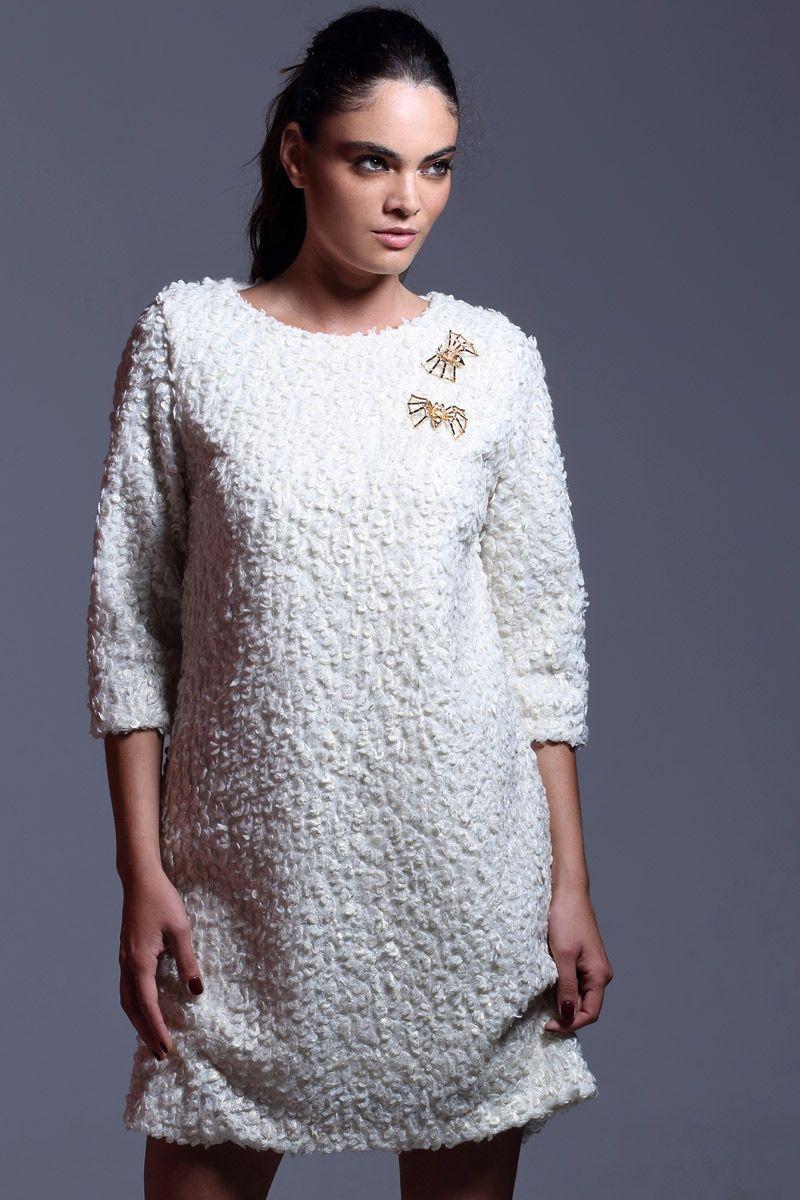 30c39d2f4c vestido blanco corto de baguilla de lana lurex de manga larga con broches  dorados con forma